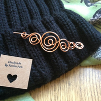 Swirly copper pin brooch for knitwear
