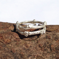 Pretty and simple handmade wraparound twig ring in recycled silver. Adjustable.