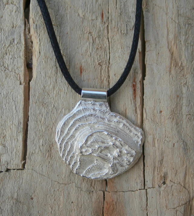 Silver pendant cast from a cuttlefish