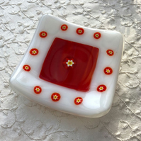 White and orange fused glass trinket dish with inset millefiori (little flowers)