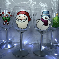 Set of four hand painted Christmas wine glasses