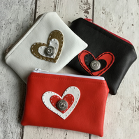 A Trio of Faux Leather Heart Embellished Coin Purses