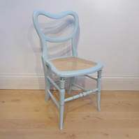 Antique chair in duck egg blue chalk paint, re-caned seat
