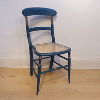 Antique chair in teal blue chalk paint, re-caned seat