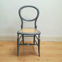 Antique chair in pale grey chalk paint