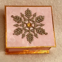 Luxury copper and gold box filled with candles