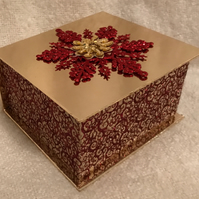 Gold and burgundy box filled with tealights ad votives