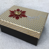 Beautiful burgundy and gold box containing candle, votives and glass plate
