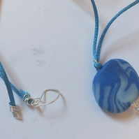 Marbled blue and white lentil bead pendant