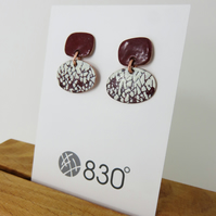 Two part, dangle, textured dark red and ivory enamel earrings
