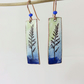Dangle enamel on copper earrings with colour washes and leaf detail.