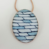 Oval Shaped Pendant in Blue and White Enamel with a Hand Drawn Pattern