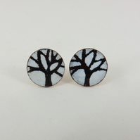 Round copper stud earrings with hand drawn tree motif.