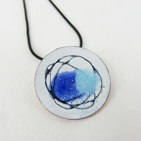 Round enamel and copper pendant with a hand drawn lines and colour.