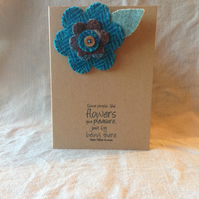 A flower shaped, hand sewn brooch, Harris tweed, backed with felt.