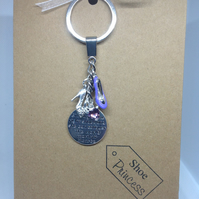 Shoe themed keyring attached to a Kraft greetings card
