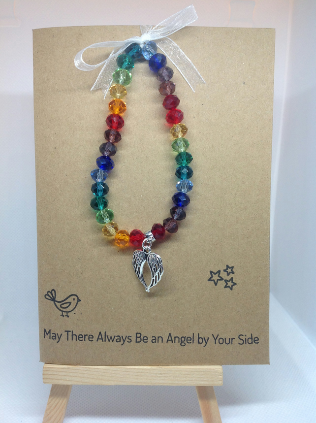 stretch bracelet, rainbow glass beads with angel wings charms on greetings card