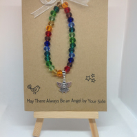 stretch bracelet, rainbow glass beads with angel charm on greetings card