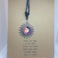 Hand made necklace on leather thong, attached to hand stamped greetings card