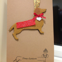 Handmade felt dachshund attached to card with envelope.