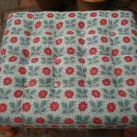 Large buttoned green and red floral footstool