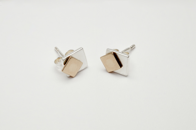 Tana by Fedha - understated movable geometric silver and gold stud earrings