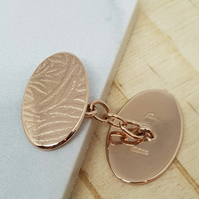 Matias by Fedha - embossed rose gold-plated cufflinks with chain fastening