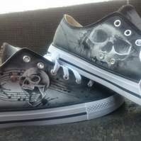 Custom hand painted skulls and music themed sneakers