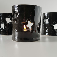 Ceramic black tealight holder with stars