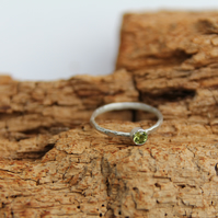 faceted Peridot stone ring