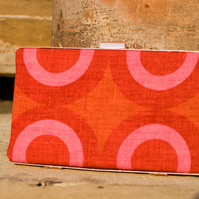 Minaudiere clutch bag in red patterned linen