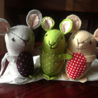 Handsewn, hand sized nice mice made from felt and fun