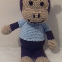Crocheted Amigurumi playful monkey