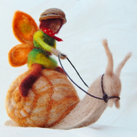 Fairy riding a snail Needle felted sculpture