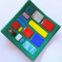 Bright multicoloured and green glass plate or trinket tray.