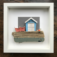 Pale Blue Beach Hut with Sandcastle framed picture