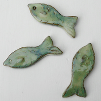 Three fish fridge manets