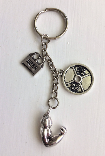 Ultimate training fitness Keyring with beer, weight plate and bicep muscle charm