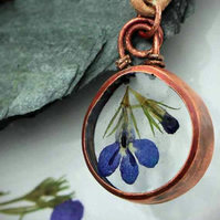 Handmade Pendant featuring pressed blue Lobelia and bud flowers