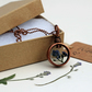 Handmade recycled copper pipe pendant featuring pressed Forget Me Nots
