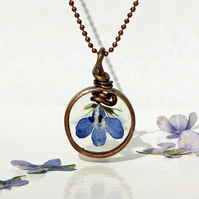 Handmade Pendant featuring pressed blue Lobelia flower