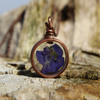 Handmade Copper Pipe Pendant featuring real pressed flower purple larkspur