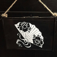 Paper cut fan, handmade in glass hanging frame.