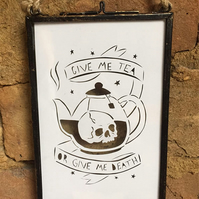Give me tea or give me death. Tea lover skull paper cut in glass hanging frame.