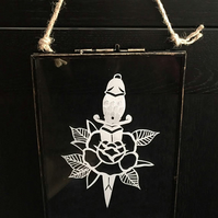Dagger and rose papercut design in glass hanging frame.