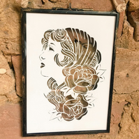 Gypsy girl papercut design in glass hanging frame.