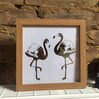 Flamingos papercut in box frame.