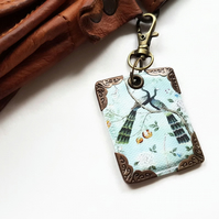 Chinoiserie keyring in faux vegan leather.