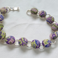 Green and Purple Design Fabric Covered Button Bracelet