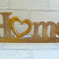 Hand crafted Gold 'Home' stand up sign. Distressed, mixed media.